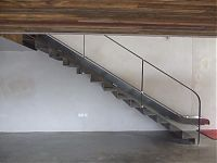 Mild steel staircase with slide. side view.
