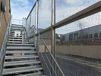 A galvanized steel staircase providing external rear access for newly built shop in Witney.