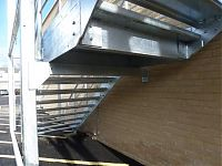 Under stair view of steel staircase to first floor.
