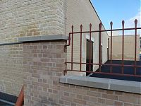 Railings for rear car park and first floor rear access, fixed to the wall with a bracket.