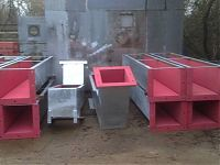 Chute sections galvanized and lined with rubber.