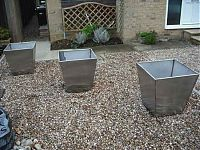 Stainless steel plant pots - perfect for a garden
