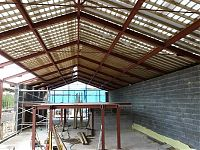 Tied portal roof trusses for a barn conversion
