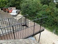 The bridge platform at the top of a bespoke fabricated steel staircase.